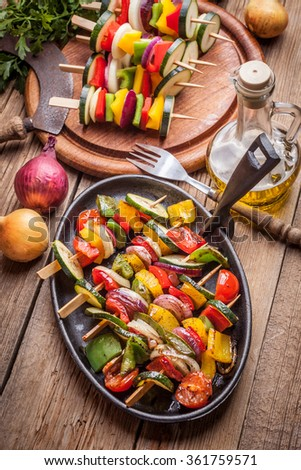 Vegetable skewers on a cast iron skillet. - stock photo