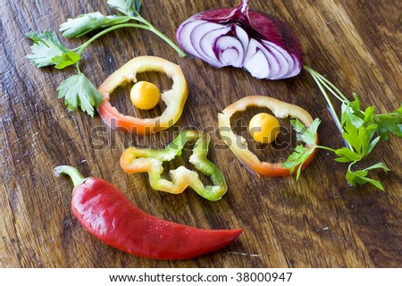Vegetable smiley from pepper, onion and parsley - stock photo