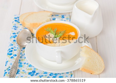 Vegetable soup and a slice of bread - stock photo