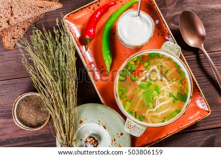 Vegetable Soup Broth With Noodles Herbs Parsley And Vegetables In Bowl With Sour