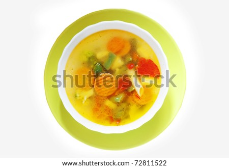 vegetable soup in a bright plate isolated
