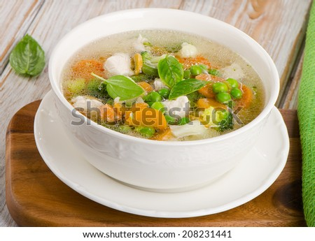 Vegetable soup in a white bowl. Selective focus
