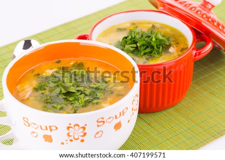 Vegetable soup in bowls on green bamboo background. - stock photo
