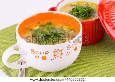 Vegetable soup in bowls on green bamboo background.
