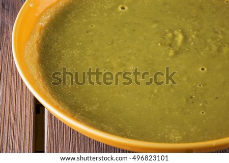 Vegetable soup in yellow plate, horizontal image