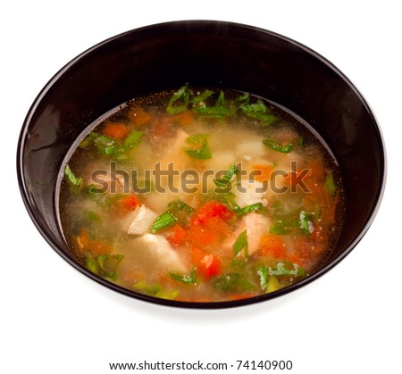 Vegetable soup with chicken isolated - stock photo