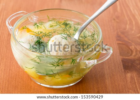 vegetable soup with chicken meatballs in a plate - stock photo