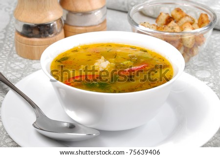 Vegetable soup with croutons in the white bowl - stock photo