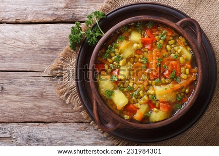 Vegetable soup with mungbeen closeup on the table. top view horizontal  - stock photo