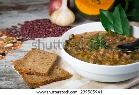 Vegetable soup with pumpkin and onion served with toasted brown bread - stock photo