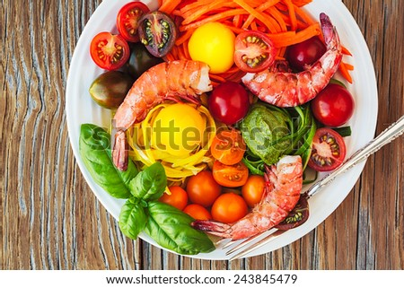 Vegetable Zucchini Spaghetti Pasta Noodle Dish With Fresh Shrimp, Basil Pesto, Heirloom Tomatoes, Sous Vide Egg Yolks, Carrots On Instagram Style Vintage Wood Table - stock photo