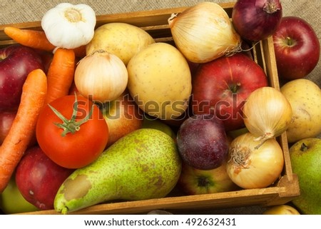 Vegetables and apples on wooden table. Autumn harvest on the farm. A healthy diet for children.