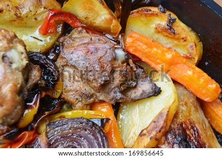vegetables and chicken in pan baked in  oven