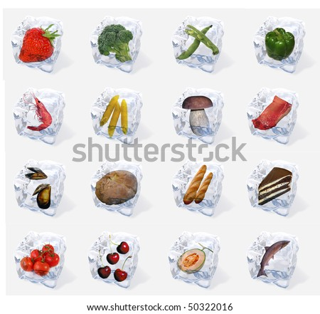 Vegetables and food frozen in ice cubes isolated on white background - stock photo