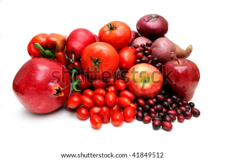 Vegetables and fruit all of red coloring including pomegranate, red pears, large and cherry tomatoes, apples, sweet potato, chili peppers and cranberries. - stock photo