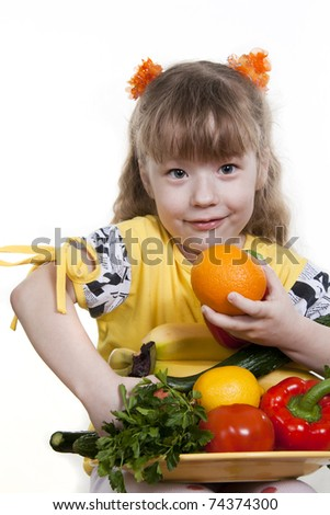 Vegetables and fruit it are a healthy food of children. Child holds different vegetables and fruit. - stock photo