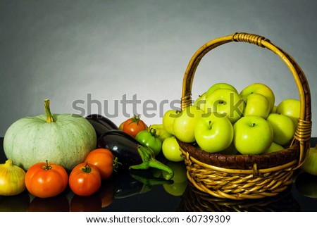 Vegetables and fruit on the dark background (design sketch autumn) - stock photo