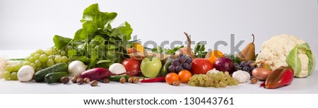 Vegetables and fruits all together on a white background