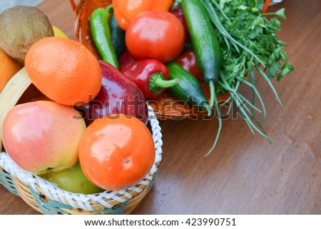 vegetables and fruits in basket - stock photo