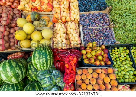 vegetables and fruits in the stores background, watermelon, melon, pepper, cucumber, peach, figs, plums, potatoes, grapes - stock photo