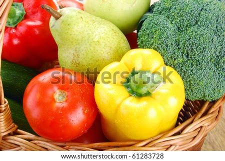 Vegetables and fruits in wicker basket - stock photo