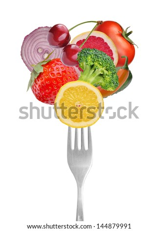 Vegetables and fruits on forks. Isolated on white