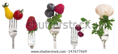 vegetables and fruits on the isolated forks, diet concept - stock photo