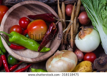 Vegetables and fruits on wood