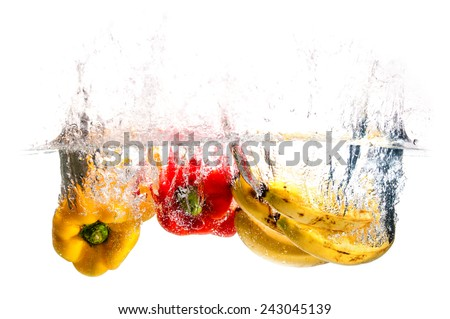 Vegetables and Fruits Splash Water - stock photo