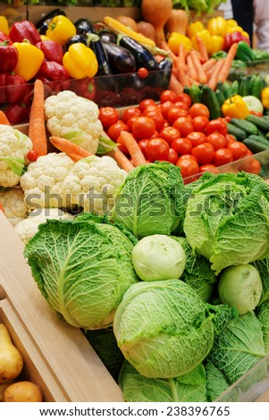 Vegetables and groceries on market display - stock photo