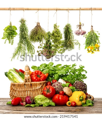 vegetables and herbs on white background. organic diary products. shopping basket. healthy food concept - stock photo