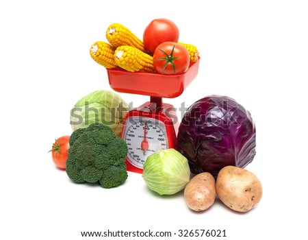 vegetables and kitchen scales on a white background. horizontal photo. - stock photo