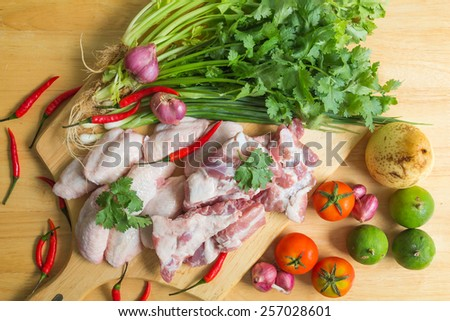 vegetables and meat on a wooden table background