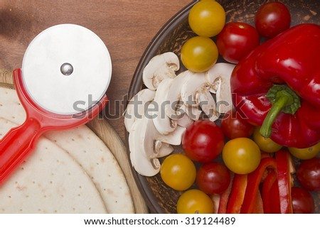 Vegetables and mushrooms - filling pizza at home. - stock photo