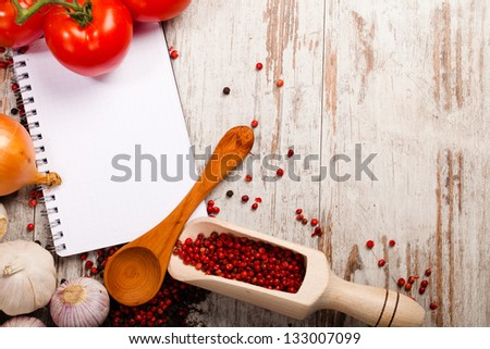 vegetables and recipe notebook on wooden background