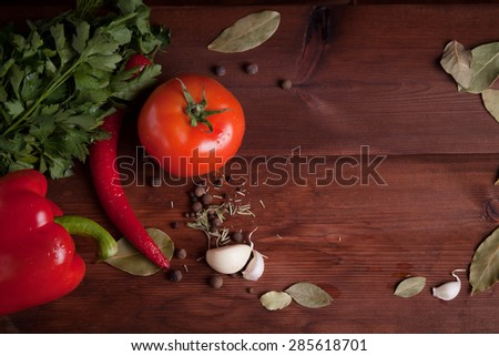 vegetables and spices on wood desk  - stock photo