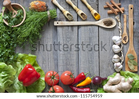 Vegetables and spices vintage border and empty cutting board - stock photo