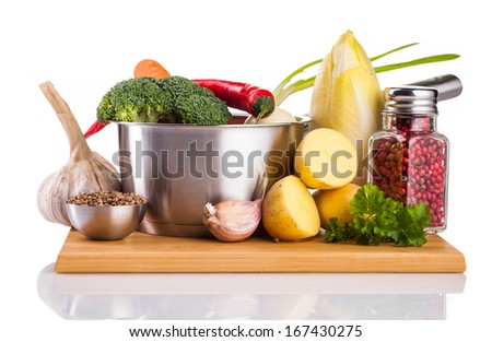 vegetables and stainless pot isolated on white