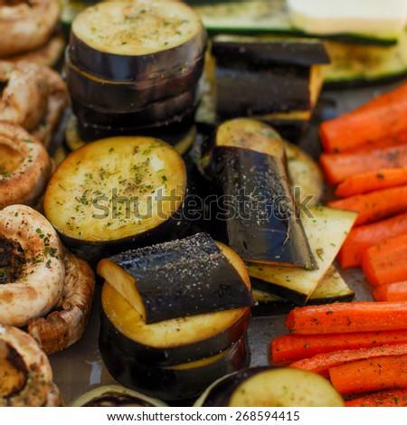 Vegetables before grilling. Carrot, aubergine, mushroom. - stock photo