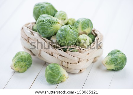 Vegetables: brussels sprouts in a wicker basket - stock photo