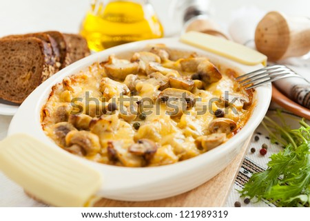 Vegetables casserole with mushrooms, potatoes and cheese closeup. Healthy and nutritious food - stock photo