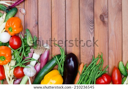 vegetables composition on wooden table - stock photo
