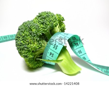 Vegetables diet, detail broccoli with meter - stock photo