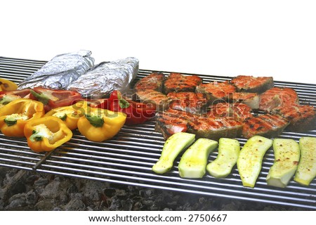 Vegetables, fish and meat fried in  barbekyu - stock photo