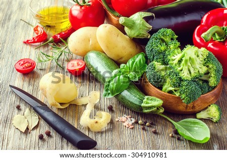 Vegetables for cooking healthy dinner, peeling potato, kitchen table, vegetarian food, fresh ingredients - stock photo