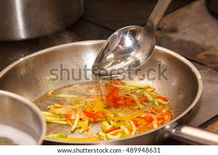 Vegetables for the sauce to pasta fried in a pan.