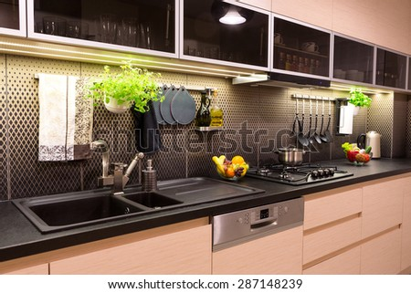 Vegetables, fruits and herbs in a contemporary kitchen. - stock photo