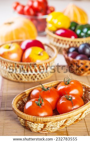 vegetables, fruits plums, apples, pumpkins, peppers, tomatoes background wooden table - stock photo