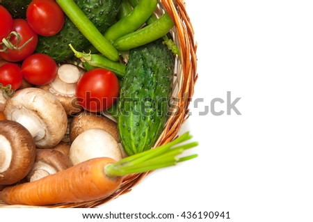 Vegetables in a basket on a white background, top view.