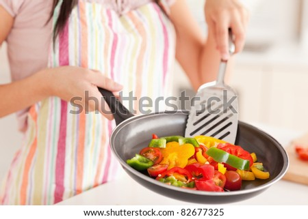 Vegetables in a frying pan are fried